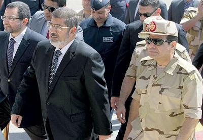 محاكمة مرسي.. وترشيح السيسي بمباركة 2009894.jpg