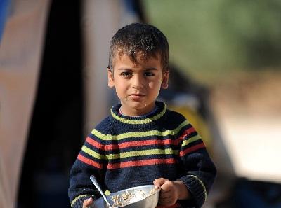 بريطانيا توافق استقبال لاجئين سوريين 20109.JPG